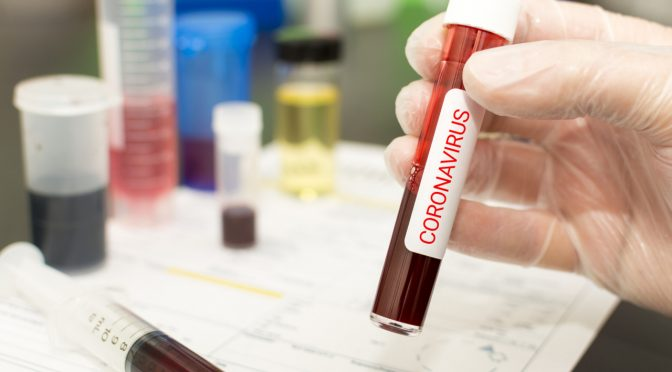 Concept to represent the 2020 virus threat Coronavirus, blood in a test tube.